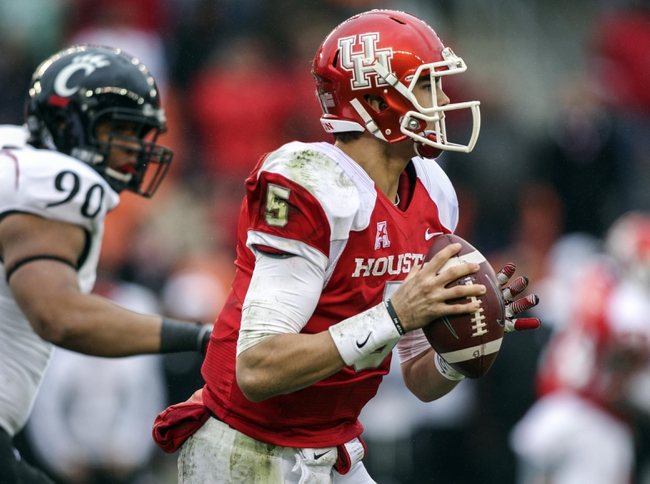 Nov 23, 2013; Houston, TX, USA; Houston Cougars quarterback John O'Korn (5) looks for an open receiver during the second quarter against the Cincinnati Bearcats at BBVA Compass Stadium. Mandatory Credit: Troy Taormina-USA TODAY Sports
