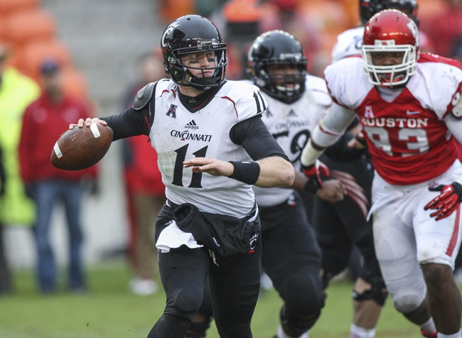 Nov 23, 2013; Houston, TX, USA; Cincinnati Bearcats quarterback Brendon Kay (11) looks for an open receiver during the second quarter against the Houston Cougars at BBVA Compass Stadium. Mandatory Credit: Troy Taormina-USA TODAY Sports