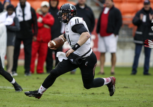 Nov 23, 2013; Houston, TX, USA; Cincinnati Bearcats quarterback Brendon Kay (11) runs with the ball during the second quarter against the Houston Cougars at BBVA Compass Stadium. Mandatory Credit: Troy Taormina-USA TODAY Sports
