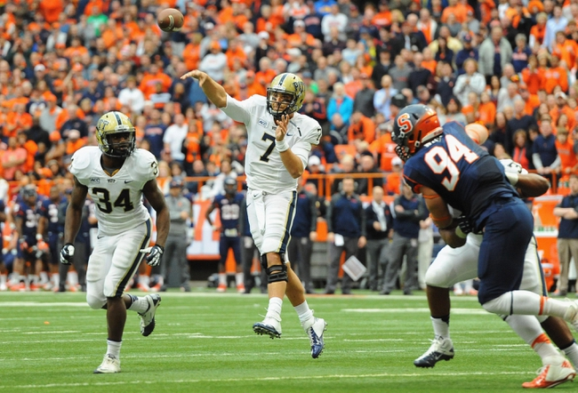 Nov 23, 2013; Syracuse, NY, USA; Pittsburgh Panthers quarterback Tom Savage (7) passes the ball against the Syracuse Orange during the second quarter at the Carrier Dome.  Mandatory Credit: Rich Barnes-USA TODAY Sports