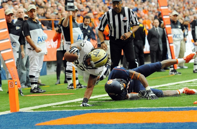 Nov 23, 2013; Syracuse, NY, USA; Pittsburgh Panthers tight end Manasseh Garner (82) dives for the end zone over Syracuse Orange safety Durell Eskridge (3) during the second quarter at the Carrier Dome.  Mandatory Credit: Rich Barnes-USA TODAY Sports