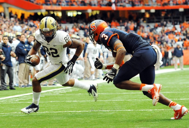 Nov 23, 2013; Syracuse, NY, USA; Pittsburgh Panthers tight end Manasseh Garner (82) runs with the ball after a catch while Syracuse Orange safety Durell Eskridge (3) defends during the second quarter at the Carrier Dome.  Mandatory Credit: Rich Barnes-USA TODAY Sports