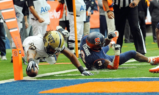 Nov 23, 2013; Syracuse, NY, USA; Pittsburgh Panthers tight end Manasseh Garner (82) dives for the end zone in front of Syracuse Orange safety Durell Eskridge (3) during the second quarter at the Carrier Dome.  Mandatory Credit: Rich Barnes-USA TODAY Sports
