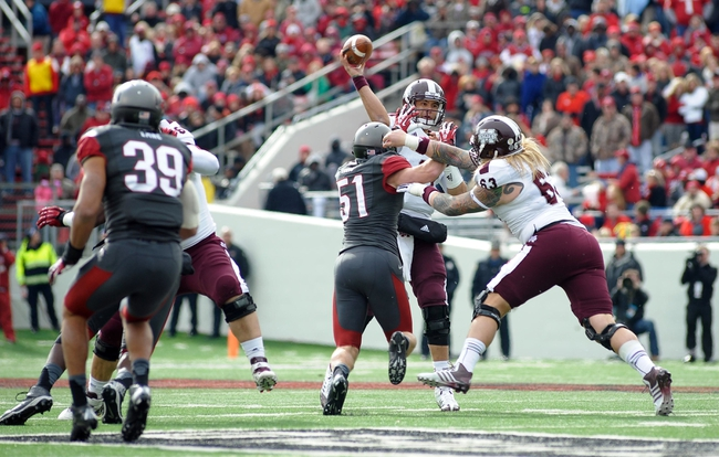 Nov 23, 2013; Little Rock, AR, USA; Mississippi State Bulldogs quarterback Tyler Russell (17) throws the ball against the Arkansas Razorbacks during the second quarter at War Memorial Stadium. Mandatory Credit: Justin Ford-USA TODAY Sports