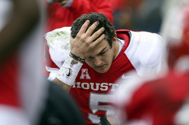 Nov 23, 2013; Houston, TX, USA; Houston Cougars quarterback John O'Korn (5) sits on the bench during the second quarter against the Cincinnati Bearcats at BBVA Compass Stadium. Mandatory Credit: Troy Taormina-USA TODAY Sports