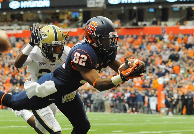 Nov 23, 2013; Syracuse, NY, USA; Syracuse Orange wide receiver Alvin Cornelius (82) makes a catch in front of Pittsburgh Panthers defensive back Lafayette Pitts (23) during the third quarter at the Carrier Dome.  Mandatory Credit: Rich Barnes-USA TODAY Sports