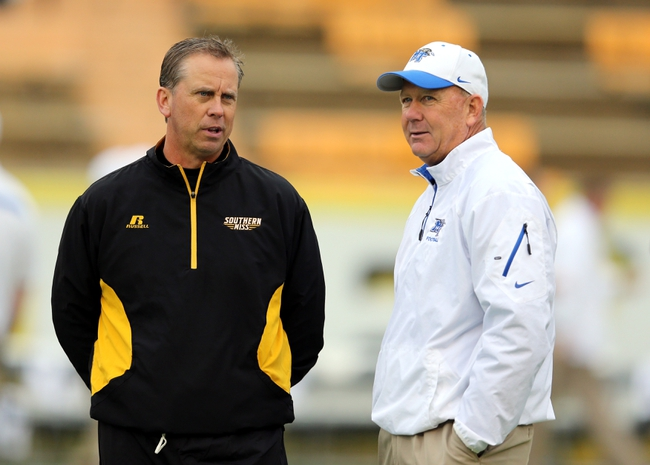 Nov 23, 2013; Hattiesburg, MS, USA; Southern Miss Golden Eagles head coach Todd Monken talks to Middle Tennessee Blue Raiders head coach Rick Stockstill before their game at M.M. Roberts Stadium. Mandatory Credit: Chuck Cook-USA TODAY Sports