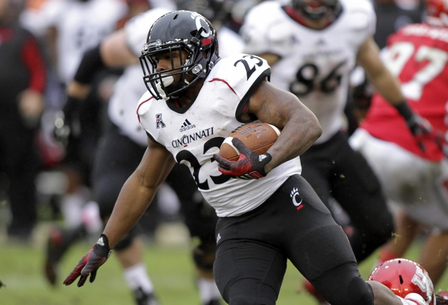 Nov 23, 2013; Houston, TX, USA; Cincinnati Bearcats running back Hosey Williams (23) rushes during the third quarter against the Houston Cougars at BBVA Compass Stadium. Mandatory Credit: Troy Taormina-USA TODAY Sports