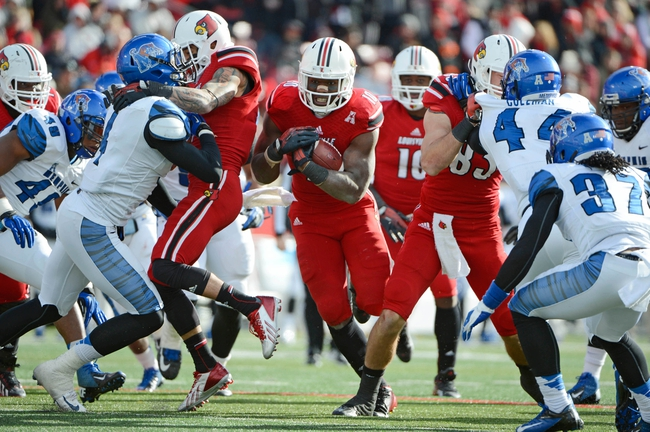 Nov 23, 2013; Louisville, KY, USA; Louisville Cardinals running back Dominique Brown (10) runs the ball against the Memphis Tigers during the second quarter at Papa Johns Cardinal Stadium. Louisville defeated Memphis 24-17.  Mandatory Credit: Jamie Rhodes-USA TODAY Sports