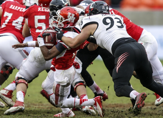 Nov 23, 2013; Houston, TX, USA; Houston Cougars quarterback Greg Ward Jr. (1) is sacked by Cincinnati Bearcats defensive end Brad Harrah (93) during the fourth quarter at BBVA Compass Stadium. The Bearcats defeated the Cougars 24-17. Mandatory Credit: Troy Taormina-USA TODAY Sports