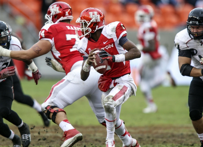 Nov 23, 2013; Houston, TX, USA; Houston Cougars quarterback Greg Ward Jr. (1) runs with the ball during the fourth quarter against the Cincinnati Bearcats at BBVA Compass Stadium. The Bearcats defeated the Cougars 24-17. Mandatory Credit: Troy Taormina-USA TODAY Sports
