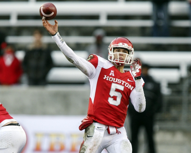 Nov 23, 2013; Houston, TX, USA; Houston Cougars quarterback John O'Korn (5) attempts a pass during the fourth quarter against the Cincinnati Bearcats at BBVA Compass Stadium. The Bearcats defeated the Cougars 24-17. Mandatory Credit: Troy Taormina-USA TODAY Sports