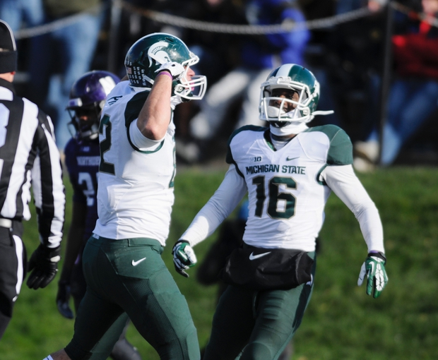 Nov 23, 2013; Evanston, IL, USA; Michigan State Spartans tight end Josiah Price (82) is congratulated by wide receiver Aaron Burbridge (16) after a touchdown during the second half against the Northwestern Wildcats at Ryan Field. Michigan State won 30-6. Mandatory Credit: Reid Compton-USA TODAY Sports