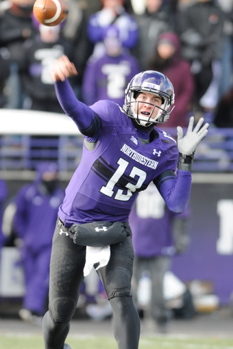 Nov 23, 2013; Evanston, IL, USA; Northwestern Wildcats quarterback Trevor Siemian (13) throws a pass during the second half against the Michigan State Spartans at Ryan Field. Michigan State won 30-6. Mandatory Credit: Reid Compton-USA TODAY Sports