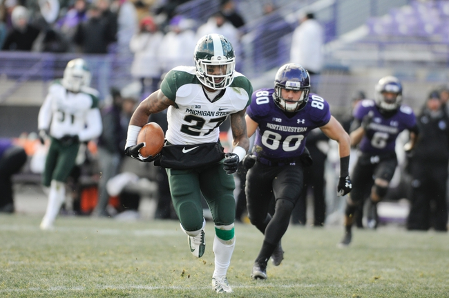 Nov 23, 2013; Evanston, IL, USA; Michigan State Spartans safety Kurtis Drummond (27) intercepts a pass during the second half against the Northwestern Wildcats at Ryan Field. Michigan State won 30-6. Mandatory Credit: Reid Compton-USA TODAY Sports