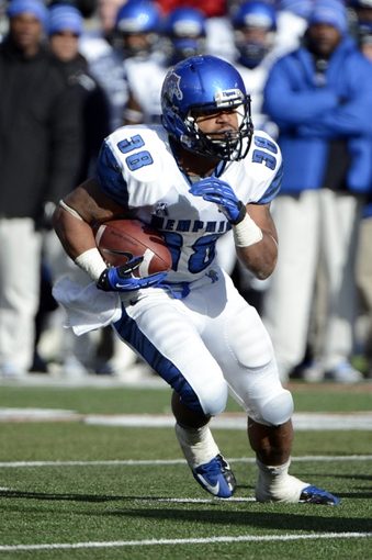 Nov 23, 2013; Louisville, KY, USA; Memphis Tigers running back Brandon Hayes (38) runs the ball against the Louisville Cardinals during the second quarter at Papa Johns Cardinal Stadium. Louisville defeated Memphis 24-17.  Mandatory Credit: Jamie Rhodes-USA TODAY Sports