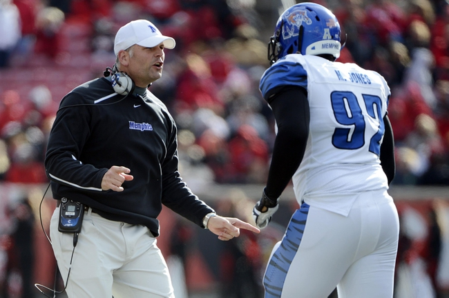 Nov 23, 2013; Louisville, KY, USA; Memphis Tigers head coach Justin Fuente talks with defensive lineman Melvin Jones (92) during the second half against the Louisville Cardinals at Papa Johns Cardinal Stadium. Louisville defeated Memphis 24-17.  Mandatory Credit: Jamie Rhodes-USA TODAY Sports