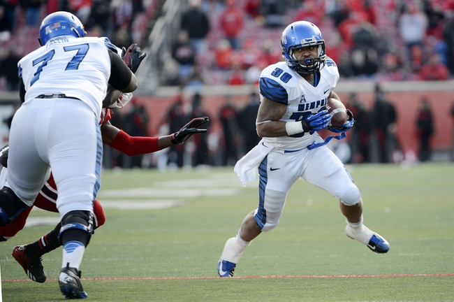 Nov 23, 2013; Louisville, KY, USA; Memphis Tigers running back Brandon Hayes (38) runs the ball against the Louisville Cardinals during the second half at Papa Johns Cardinal Stadium. Louisville defeated Memphis 24-17.  Mandatory Credit: Jamie Rhodes-USA TODAY Sports