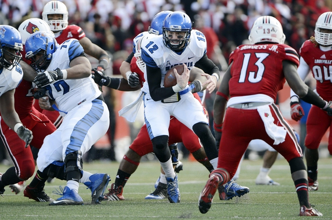 Nov 23, 2013; Louisville, KY, USA; Memphis Tigers quarterback Paxton Lynch (12) runs the ball against the Louisville Cardinals during the second half at Papa Johns Cardinal Stadium. Louisville defeated Memphis 24-17.  Mandatory Credit: Jamie Rhodes-USA TODAY Sports