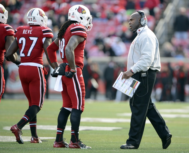 Nov 23, 2013; Louisville, KY, USA; Louisville Cardinals head coach Charlie Strong talks with cornerback Terell Floyd (19) following a penalty during the second half against the Memphis Tigers  at Papa Johns Cardinal Stadium. Louisville defeated Memphis 24-17.  Mandatory Credit: Jamie Rhodes-USA TODAY Sports