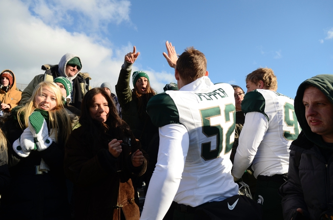 Nov 23, 2013; Evanston, IL, USA; Michigan State Spartans players and fans celebrate their victory over the Northwestern Wildcats at Ryan Field. Michigan State won 30-6. Mandatory Credit: Reid Compton-USA TODAY Sports