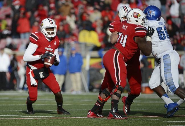 Nov 23, 2013; Louisville, KY, USA; Louisville Cardinals quarterback Teddy Bridgewater (5) scrambles with the ball against the Memphis Tigers during the second half at Papa Johns Cardinal Stadium. Louisville defeated Memphis 24-17.  Mandatory Credit: Jamie Rhodes-USA TODAY Sports