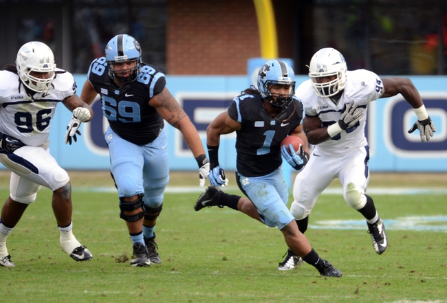Nov 23, 2013; Chapel Hill, NC, USA; North Carolina Tar Heels running back Khris Francis (1) runs against the Old Dominion Monarchs as defender Scott Wiggins (94) pursues  during the second half at Kenan Memorial Sta