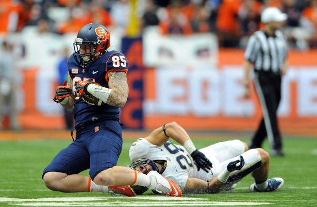 Nov 23, 2013; Syracuse, NY, USA; Syracuse Orange tight end Beckett Wales (85) is tackled by Pittsburgh Panthers linebacker Anthony Gonzalez (28) during the third quarter at the Carrier Dome.  Pittsburgh defeated Syracuse 17-16.  Mandatory Credit: Rich Barnes-USA TODAY Sports