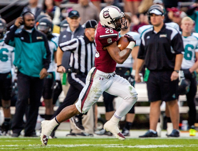 Nov 23, 2013; Columbia, SC, USA; South Carolina Gamecocks running back Jamari Smith (26) rushes for a 52 yard gain against the Coastal Carolina Chanticleers in the second half at Williams-Brice Stadium. Mandatory Credit: Jeff Blake-USA TODAY