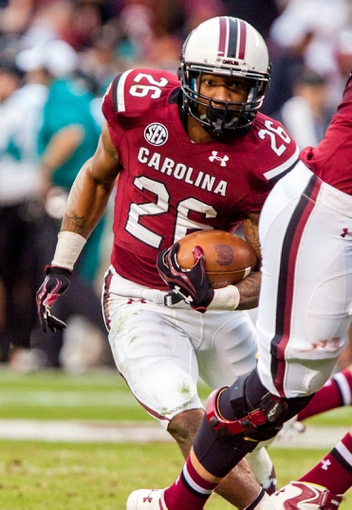 Nov 23, 2013; Columbia, SC, USA; South Carolina Gamecocks running back Jamari Smith (26) rushes against the Coastal Carolina Chanticleers in the second half at Williams-Brice Stadium. Mandatory Credit: Jeff Blake-USA TODAY