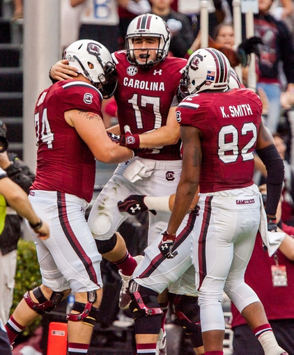Nov 23, 2013; Columbia, SC, USA; South Carolina Gamecocks quarterback Dylan Thompson (17) celebrates his touchdown with offensive tackle Mason Zandi (74) and wide receiver Kwinton Smith (82) against the Coastal Carolina Chanticleers in the second half at Williams-Brice Stadium. Mandatory Credit: Jeff Blake-USA TODAY