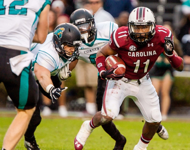 Nov 23, 2013; Columbia, SC, USA; South Carolina Gamecocks wide receiver Pharoh Cooper (11) makes a reception against the Coastal Carolina Chanticleers in the second half at Williams-Brice Stadium. Mandatory Credit: Jeff Blake-USA TODAY