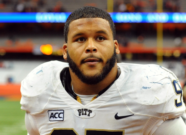 Nov 23, 2013; Syracuse, NY, USA; Pittsburgh Panthers defensive lineman Aaron Donald (97) reacts while leaving the field following the game against the Syracuse Orange at the Carrier Dome.  Pittsburgh defeated Syracuse 17-16.  Mandatory Credit: Rich Barnes-USA TODAY Sports