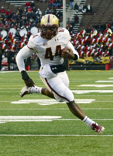 Nov 23, 2013; College Park, MD, USA;  Boston College Eagles running back Andre Williams (44) runs into the end zone for a touchdown during the first half of the game against against the Maryland Terrapins at Byrd Stadium. Mandatory Credit: Tommy Gilligan-USA TODAY Sports