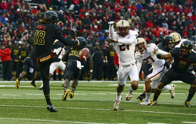 Nov 23, 2013; College Park, MD, USA; Boston College Eagles defensive back Manuel Asprilla (21) dives to block the punt by Maryland Terrapins kicker Nathan Renfro (18) during the first half at Byrd Stadium. Mandatory Credit: Tommy Gilligan-USA TODAY Sports