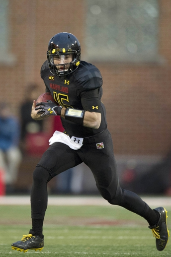 Nov 23, 2013; College Park, MD, USA; Maryland Terrapins quarterback C.J. Brown (16) scrambles with the ball  during the first half of the game against the Boston College Eagles at Byrd Stadium. Mandatory Credit: Tommy Gilligan-USA TODAY Sports
