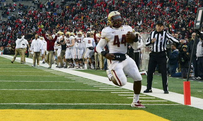 Nov 23, 2013; College Park, MD, USA;  Boston College Eagles running back Andre Williams (44) runs into the end zone for a touchdown during the first half of the game against the Maryland Terrapins at Byrd Stadium. Mandatory Credit: Tommy Gilligan-USA TODAY Sports