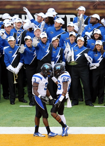 Nov 23, 2013; Hattiesburg, MS, USA; Middle Tennessee Blue Raiders wide receiver Tavarres Jefferson (3) is congratulated by Devin Clarke (86) in front of their band in the second quarter of their game against the Southern Miss Golden Eagles at M.M. Roberts Stadium. Mandatory Credit: Chuck Cook-USA TODAY Sports