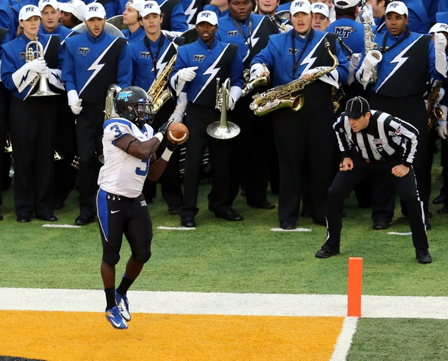 Nov 23, 2013; Hattiesburg, MS, USA; Middle Tennessee Blue Raiders wide receiver Tavarres Jefferson (3) catches a touchdown pass in the second quarter of their game against the Southern Miss Golden Eagles at M.M. Roberts Stadium. Mandatory Credit: Chuck Cook-USA TODAY Sports