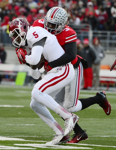 Nov 23, 2013; Columbus, OH,  Indiana Hoosiers quarterback Tre Roberson (5) is sacked by Ohio State Buckeyes defensive back Corey Brown (3) at Ohio Stadium. Mandatory Credit: Marc Lebryk-USA TODAY Sports