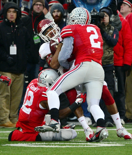 Nov 23, 2013; Columbus, OH, Indiana Hoosiers wide receiver Cody Latimer (3) is tackled by Ohio State Buckeyes defensive back Corey Brown (3) and cornerback Doran Grant (12) towards the end of the second quarter at Ohio Stadium. Mandatory Credit: Marc Lebryk-USA TODAY Sports