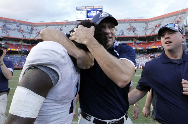 Nov 23, 2013; Gainesville, FL, USA; Georgia Southern Eagles head coach Jeff Monken hugs quarterback Jerick McKinnon (1) after they beat the Florida Gators at Ben Hill Griffin Stadium. Georgia Southern Eagles defetaed the Florida Gators 26-20. Mandatory Credit: Kim Klement-USA TODAY Sports
