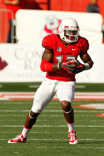 Nov 23, 2013; Fresno, CA, USA; Fresno State Bulldogs wide receiver Davante Adams (15) runs with the ball after making a catch against the New Mexico Lobos in the second quarter at Bulldog Stadium. Mandatory Credit: Cary Edmondson-USA TODAY Sports