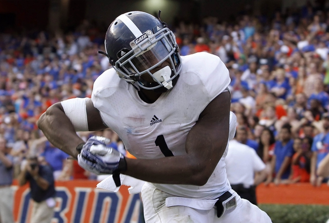 Nov 23, 2013; Gainesville, FL, USA; Georgia Southern Eagles quarterback/running back Jerick McKinnon (1) reacts after he ran the ball in for a game winning touchdown during the second half against the Florida Gators at Ben Hill Griffin Stadium. Georgia Southern Eagles defeated the Florida Gators 26-20. Mandatory Credit: Kim Klement-USA TODAY Sports