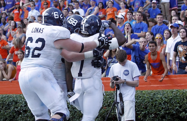 Nov 23, 2013; Gainesville, FL, USA; Georgia Southern Eagles quarterback/running back Jerick McKinnon (1) reacts with teammates after he ran the ball in for a game winning touchdown during the second half against the Florida Gators at Ben Hill Griffin Stadium. Georgia Southern Eagles defeated the Florida Gators 26-20. Mandatory Credit: Kim Klement-USA TODAY Sports