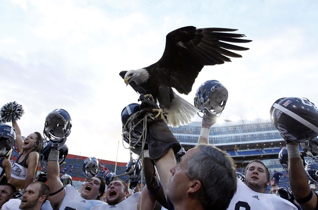 Nov 23, 2013; Gainesville, FL, USA; Georgia Southern Eagles celebrate with their eagle mascot after defeating the Florida Gators 26-20 at Ben Hill Griffin Stadium. Mandatory Credit: Kim Klement-USA TODAY Sports