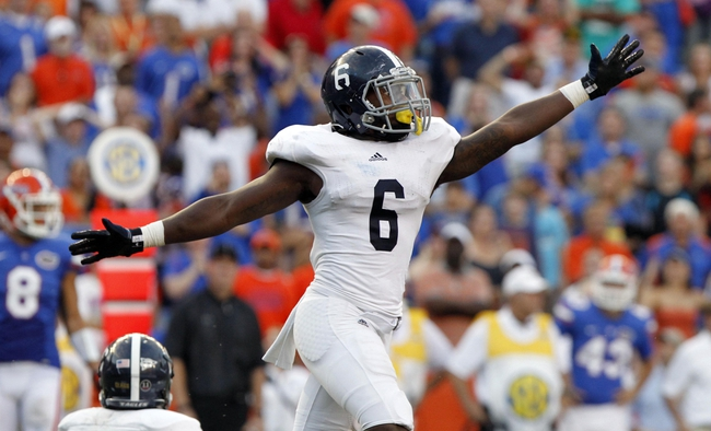 Nov 23, 2013; Gainesville, FL, USA; Georgia Southern Eagles safety Darius Safford (6) reacts after they beat the Florida Gators at Ben Hill Griffin Stadium. Georgia Southern Eagles defeated the Florida Gators 26-20. Mandatory Credit: Kim Klement-USA TODAY Sports