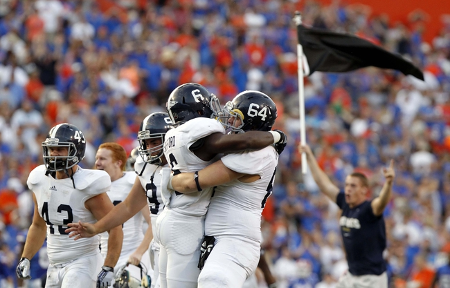 Nov 23, 2013; Gainesville, FL, USA; Georgia Southern Eagles safety Darius Safford (6), center Hunter Lamar (64) and teammates celebrate after they beat the Florida Gators at Ben Hill Griffin Stadium. Georgia Southern Eagles defeated the Florida Gators 26-20. Mandatory Credit: Kim Klement-USA TODAY Sports