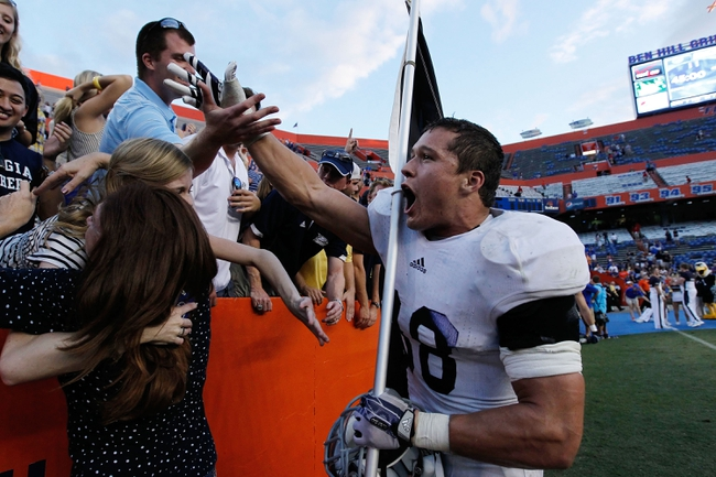 Nov 23, 2013; Gainesville, FL, USA; Georgia Southern Eagles linebacker Kyle Oehlbeck (38) high fives fans after beating the Florida Gators at Ben Hill Griffin Stadium. Georgia Southern Eagles defeated the Florida Gators 26-20. Mandatory Credit: Kim Klement-USA TODAY Sports