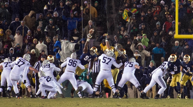 Nov 23, 2013; South Bend, IN, USA; BYU Cougars kicker Justin Sorensen attempts a field goal as Notre Dame Fighting Irish defensive end Jarron Jones (94) blocks the kick in the fourth quarter at Notre Dame Stadium. Notre Dame won 23-13. Mandatory Credit: Matt Cashore-USA TODAY Sports